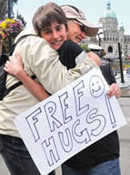 Rebecca Kennel giving out free hugs